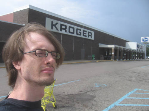 [Andrew standing in front of the recently-closed Kroger Superstore in Jackson, Michigan]