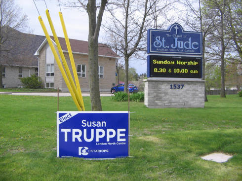 [Progressive Conservative campaign sign in front of an Anglican church]