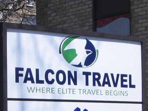 [Falcon Travel sign]