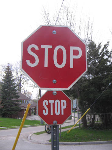 [Two Stop signs in London, Ontario]