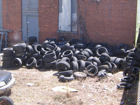 [Field full of tires (not on fire, thankfully)]