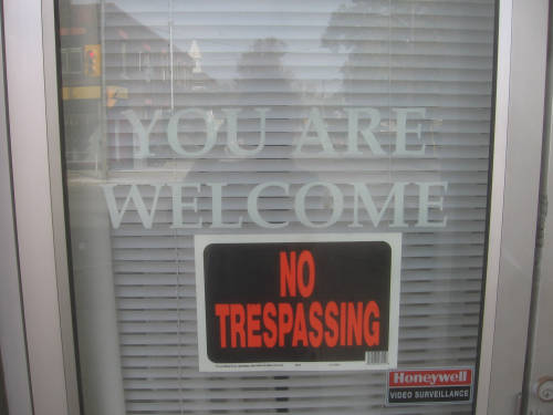 [You are Welcome/No Trespassing signs]
