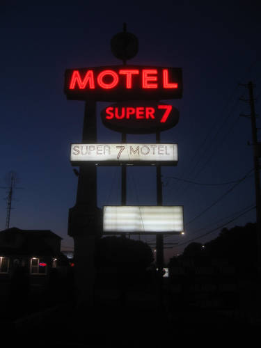 [Super 7 Motel at night]