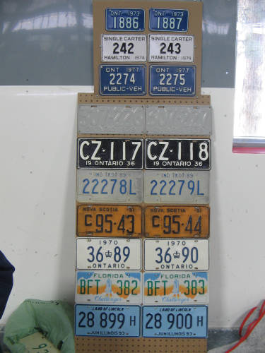 [Display of consecutively-numbered license plates]