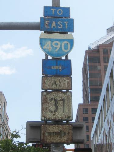 [NY 31 and I-490 signs]